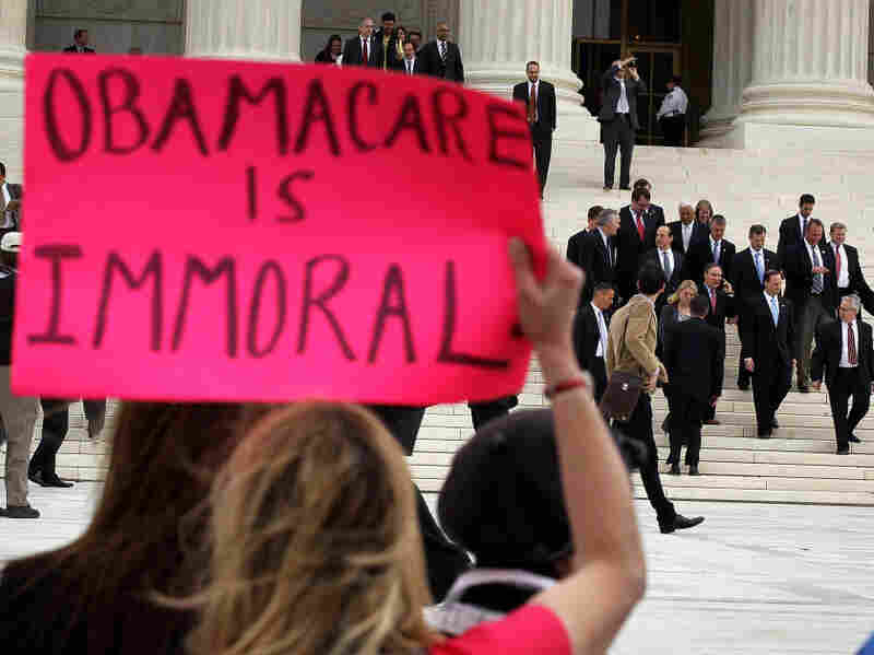 Twenty-six attorney generals, who are the plaintiffs of the lawsuit against the healthcare reform, leave the U.S. Supreme Court March 28, 2012 in Washington, DC. The high court  heard three days of argument on the Patient Protection and Affordable Care Act.