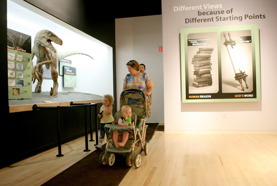 Elizabeth Burrows of LaGrange, Kentucky, walks with her children, as they tour the Creation Museum in Petersburg, Kentucky. The privately funded museum exhibits the Earth's history according to the Bible.