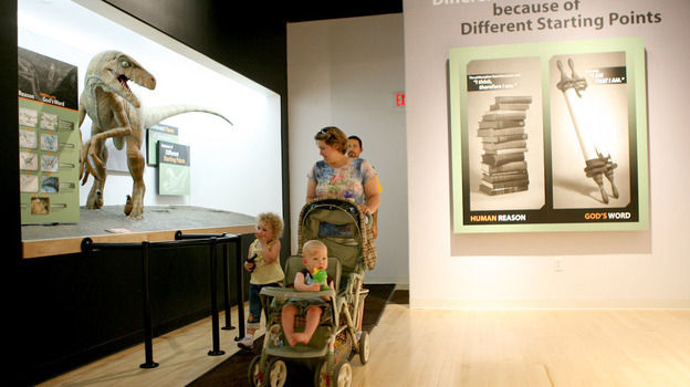 Elizabeth Burrows of LaGrange, Kentucky, walks with her children, as they tour the Creation Museum in Petersburg, Kentucky. The privately funded museum exhibits the Earth's history according to the Bible. (Getty Images)