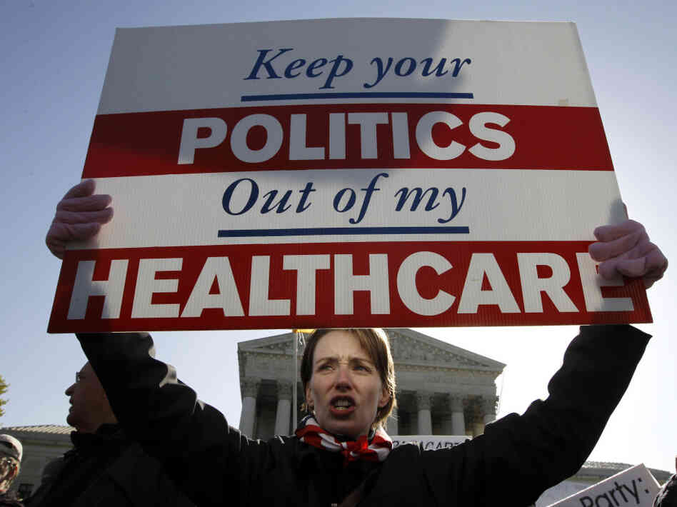 Amy Brighton from Medina, Ohio, who opposes the new health care law, rallies in front of the Supreme Court on Tuesday.