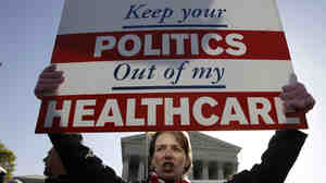 Amy Brighton from Medina, Ohio, who opposes the new health care law, rallies in front of the Supreme Cour