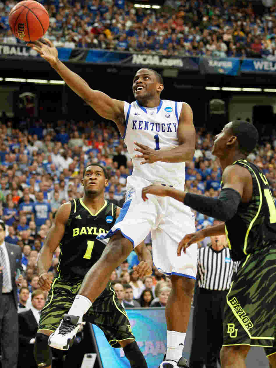Senior guard Darius Miller of Kentucky shoots during the Wildcats' win over Baylor in the South Regional final. Kentucky, the NCAA Tournament's No. 1 seed, faces rival Louisville in the Final Four Saturday.