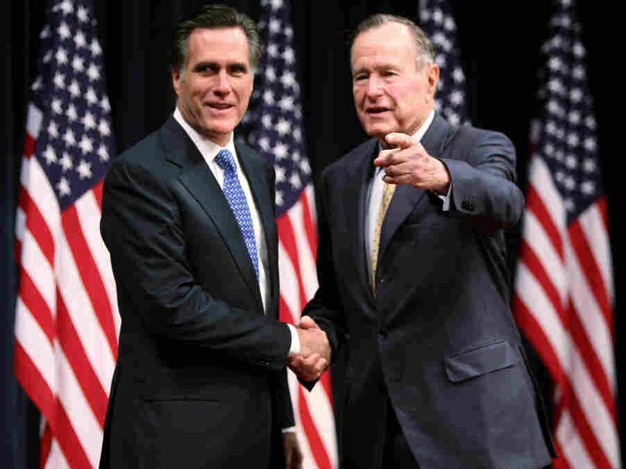 Mitt Romney (left) and former President George H.W. Bush in 2007.