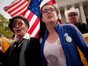 Linda Dorr (left) and Keli Carender chant along with other demonstrators in front of the Supreme Court on Wednesday.