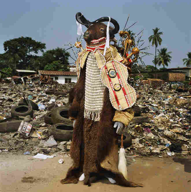 """On festival days in Freetown, Sierra Leone,"" National Geographic reads, ""social clubs parade in the streets, led by an ancestral 'devil.' This fierce and fancy water buffalo spirit is the figurehead for a men's group."""