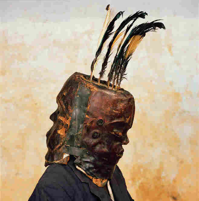 """I took this photograph when I was visiting the Cross River village of Nkim,"" tells National Geographic. ""There was no masquerade going on at the time. But carved-wood, animal-skinned Janus masks like this one appear at funerals, ceremonies honoring Nigerian kings and chiefs, and other rituals."""
