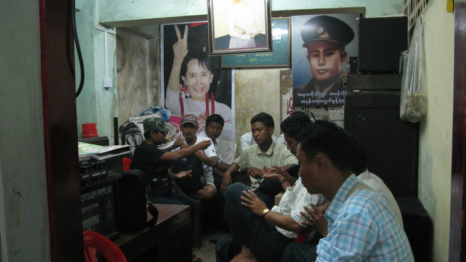 National League for Democracy members sit in the party's youth division office under pictures of party leader Aung San Suu Kyi, and her father, Burmese independence hero Gen. Aung San.