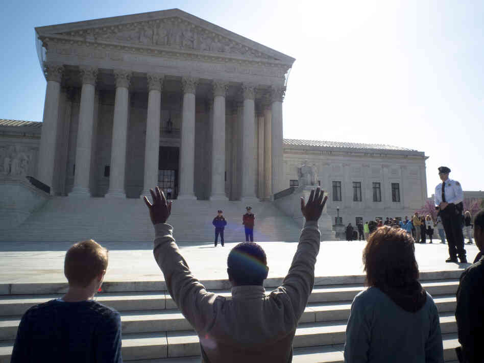 Anti-abortion protesters pray outside the U.S. Supreme Court on the third day of oral arguements over the constitutionality of the Patient Protection and Affordable Care Act on March 28, 2012 in Washington, D.C.