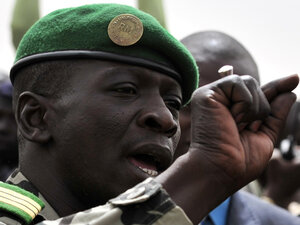 Malian military junta leader Amadou Sanogo speaks to supporters at Bamako airport on March 29, 2012 in Bamako. A bid by west African leaders to seek a return to democratic rule in Mali fell apart Thursday when the team turned back mid-air after a pro-coup demonstration in Bamako airport.