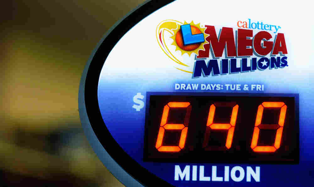 A sign displays the $640 Mega Millions jackpot at Liquorland on in Covina, California.