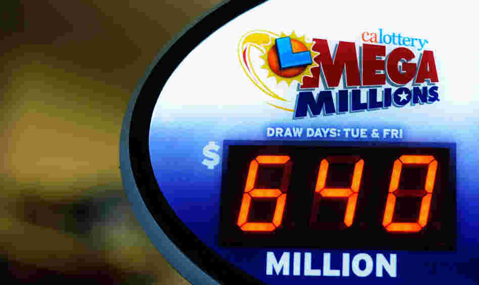 A sign displays the $640 Mega Millions jackpot at Liquorland on in Covina, California.