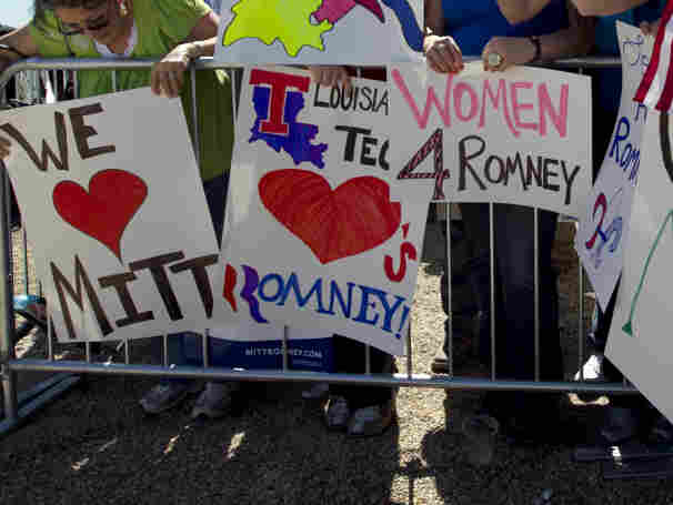 Supporters of Republican presidential candidate, former Massachusetts Gov. Mitt Romney display placards while waiting for the start of a campaign event near a natural gas drilling rig, in Shreveport, La., Friday, March 23, 2012.