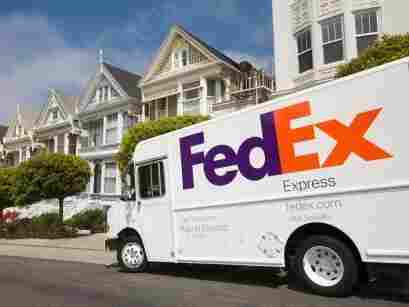 "A FedEx hybrid delivery truck. In FedEx's fleet of over 90,000 vehicles, 408 are hybrid or electric, and 4,000 are fuel-efficient, lower-emitting ""Sprinter"" vans."