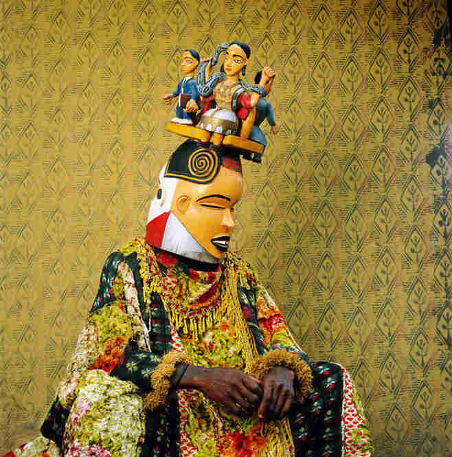 """""""The diverse Cross River region [in Nigeria] is home to a host of masquerade traditions,"""" the magazine reads. """"In the village of Alok a carving of the female water spirit Mami Wata crowns a costumed man's headdress."""""""