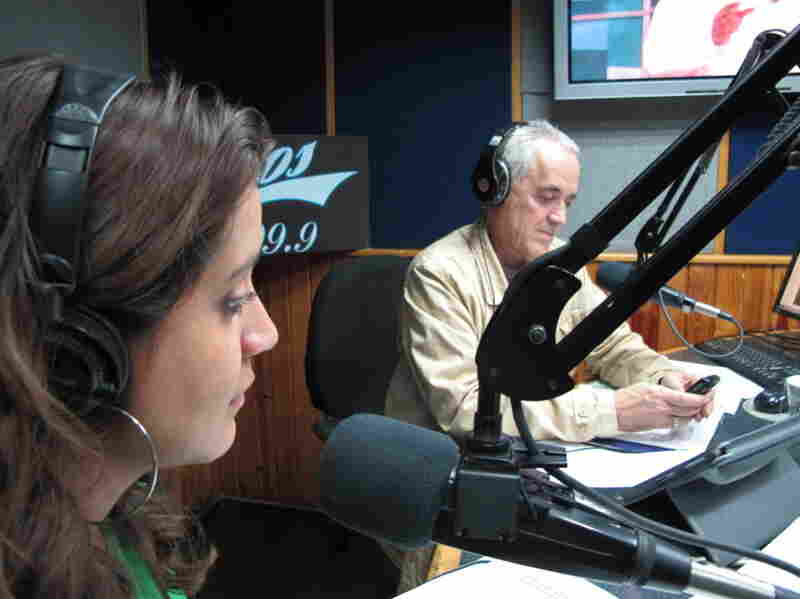 Venezuelan radio host Nelson Bocaranda (right) anchors his evening talk show, The Happy Traffic Jam, with co-host Mariela Celis in Caracas during a recent March broadcast.