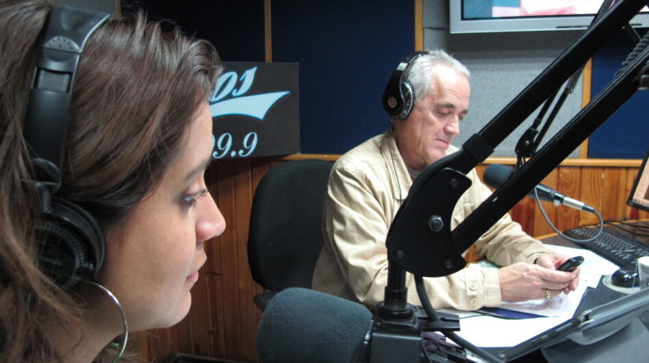 Venezuelan radio host Nelson Bocaranda (right) anchors his evening talk show, <em>The Happy Traffic Jam</em>, with co-host Mariela Celis in Caracas during a recent March broadcast.