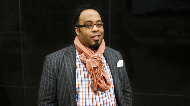 Poet Kevin Young visits NPR headquarters in Washington, D.C., on Friday as a NewsPoet guest. (NPR)