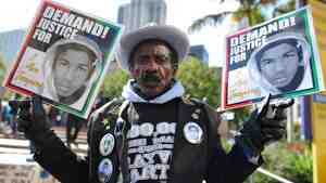 A man joins nationwide protests in memory of slain Florida teenager Trayvon Martin, in downtown Los An