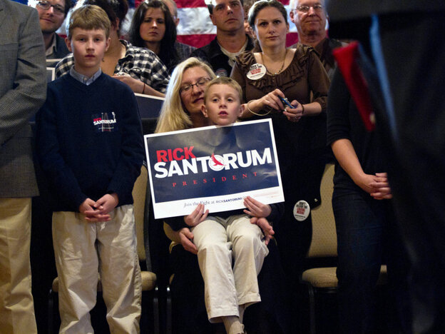 Supporters listen to Republican presidential candidate Rick Santorum at The Ravine in Bellevue, Wis., on March 24. Some voters in the state are complaining about a barrage of negative ads in advance of Tuesday's primary.