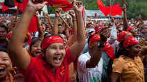 Supporters of the opposition National League for Democracy celebrate their victory in parliamentary elections outside the party headquarters in Yangon, Myanmar, on Sunday. The results could help to consolidate support for political reforms and herald the end of foreign sanctions on the country.