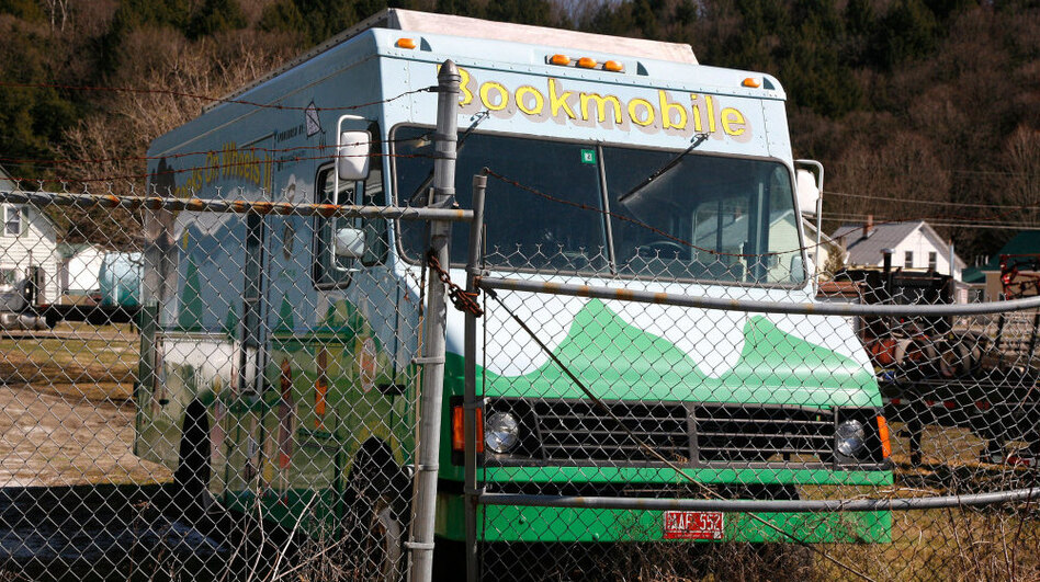 The broken-down Cobleigh Public Library bookmobile sits idle at a storage facility in Lyndonville, Vt. Supporters are raising money to put it back on the road.