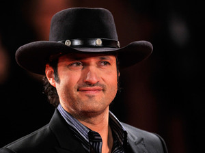 Director Robert Rodriguez, whose films including El Mariachi and Spy Kids often feature Hispanic actors, has partnered with Comcast to head the El Rey cable network. Its programming will be aimed at a bicultural, English-speaking audience.