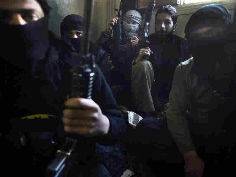 Members of the rebel 'Free Syrian Army' gather inside their quarters in the Syrian town of Binnish, in the restive northern Idlib province, on March 22, 2012. The people in this northwestern town of 30,000 near the Turkish border have been expecting the worst, as nearby villages are besieged by tanks, then attacked and captured.