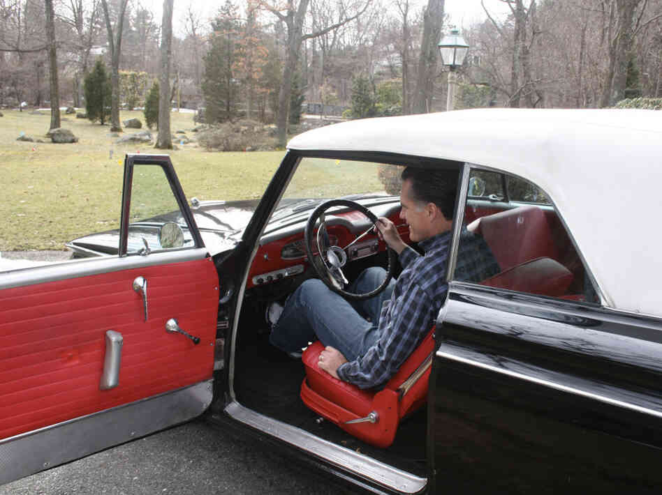 Romney sits in a 1962 Rambler American, a 60th-birthday present from his son, on March 12, 2007, at his home in Belmont, Mass. Romney's father, George Romney, was president of American Motors Corp., which built the car.