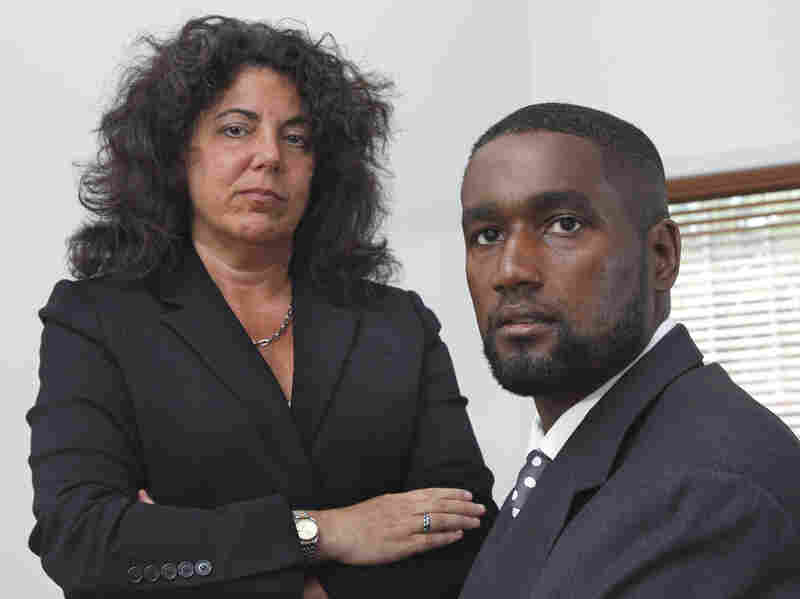 In this Oct. 11, 2011, photo, Albert Florence sits at his home in Bordentown, N.J., with his attorney, Susan Chana Lask. Florence sued after being strip-searched in 2005 when he was arrested because of a computer error.