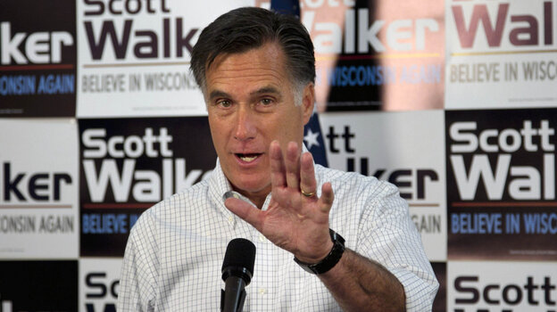 Mitt Romney has campaigned in the shadow of embattled Republican Gov. Scott Walker, who faces a recall vote in June. Here, Romney speaks with Walker supporters at a phone bank during a campaign stop in Fitchburg, Wis., on Saturday.