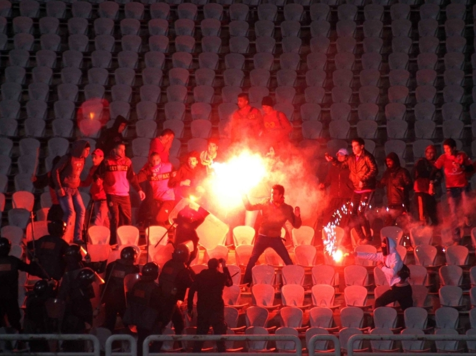 Egyptian soccer fans clash with riot police following a match between the hometown Al-Masry team and Cairo's Al-Ahly at the soccer stadium in Port Said, Egypt, on Feb. 1.  (AP)
