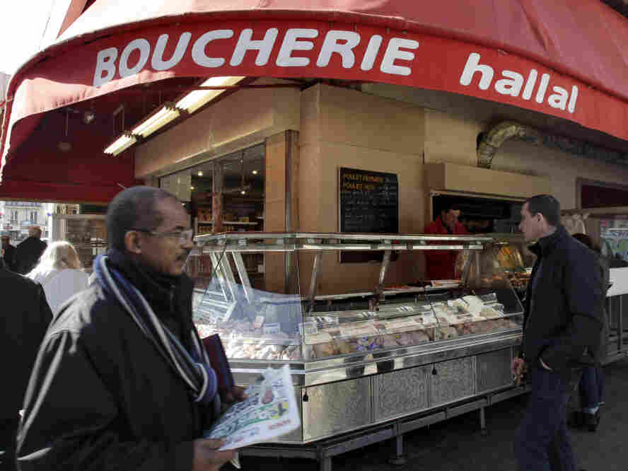 A butcher shop in Paris, which prominently advertises that it sells halal meat.