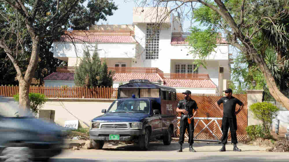 Pakistani security personnel stand guard outside the house in Islamabad where family members of al-Qaida chief Osama bin Laden are being held.