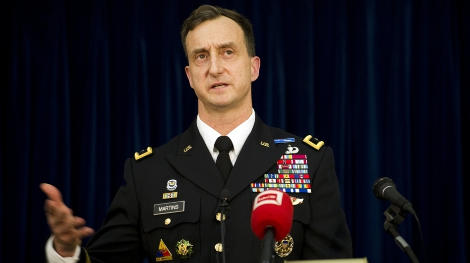 Brig. Gen. Mark Martins, the chief prosecutor at Guantanamo Bay, graduated first in his class at West Point, studied as a Rhodes scholar, and attended Harvard Law School. Here he speaks during a press conference at the military facility on Jan 18. following a hearing against Abd al-Rahim al-Nashiri, the main suspect in the bombing of the USS Cole in 2000. (AFP/Getty Images)