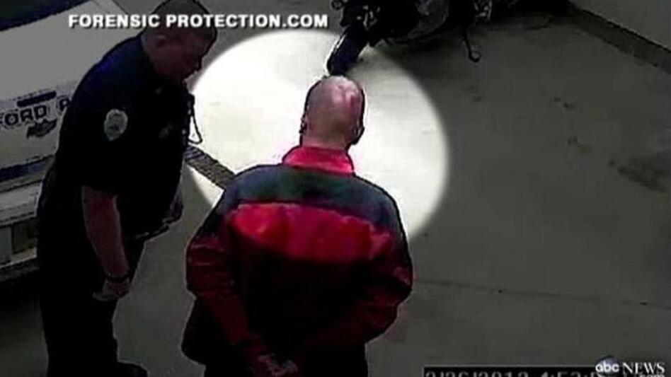 From the enhanced version of the video, showing what may be a gash on George Zimmerman's head.  (ABC News)