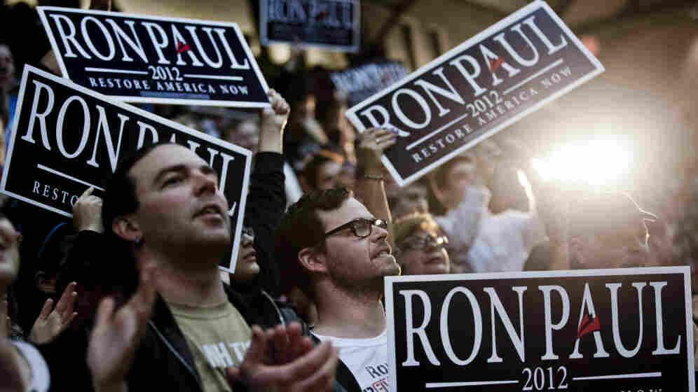 Supporters of Texas Rep. Ron Paul cheer as the Republican presidential candidate speaks on March 28 at the University of Maryland in College Park, Md.
