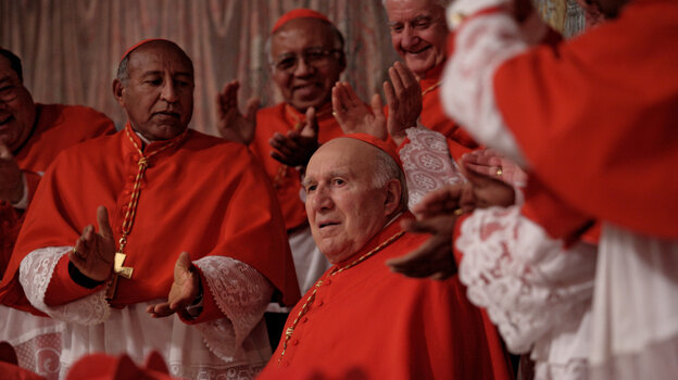 Reluctant Papa: Michel Piccoli (center) plays Melville, a cardinal surprisingly elected pope by his peers. At a critical moment before he must address his new flock, Melville insists he can't take the job.