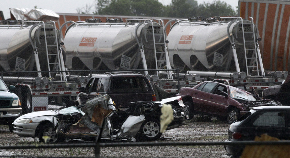 Destroyed vehicles sit in a Kenworth trailer lot after a tornado that swept through the area toppling many of the trailers on the lot on Tuesday in Lancaster, Texas.