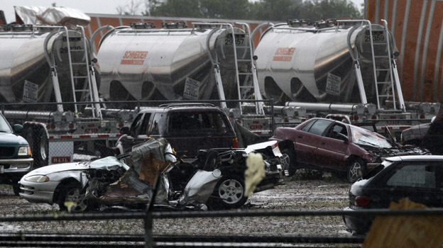 Destroyed vehicles sit in a Kenworth trailer lot after a tornado that swept through the area toppling many of the trailers on the lot on Tuesday in Lancaster, Texas.  (AP)