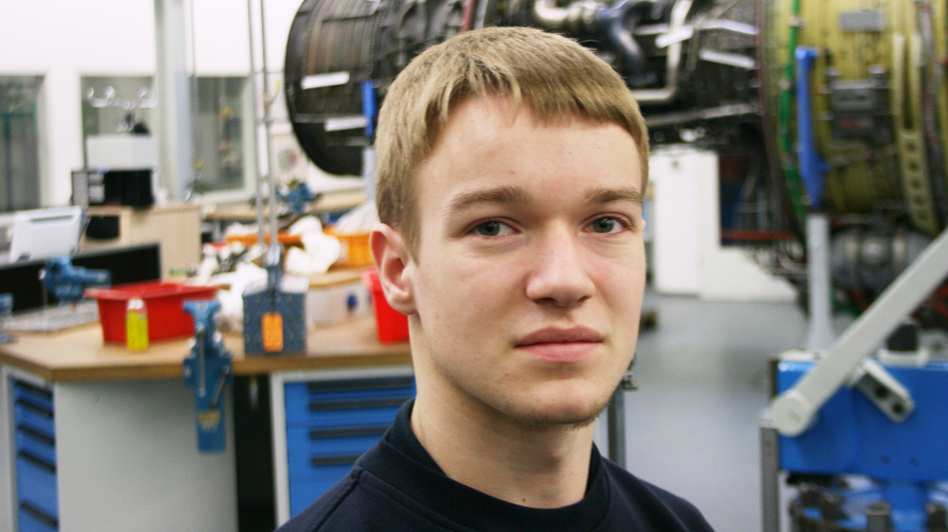 Robin Dittmar, 18, works at the Lufthansa Technik training center in Hamburg. He is about a third of the way through his apprenticeship as an aircraft mechanic and is confident his training will translate into a full-time job. (NPR)