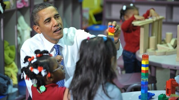 President Obama plays with children at a Head Start center in Yeadon, Pa. The Obama administration is requiring some Head Start programs to compete for continued federal funding. (AFP/Getty Images)