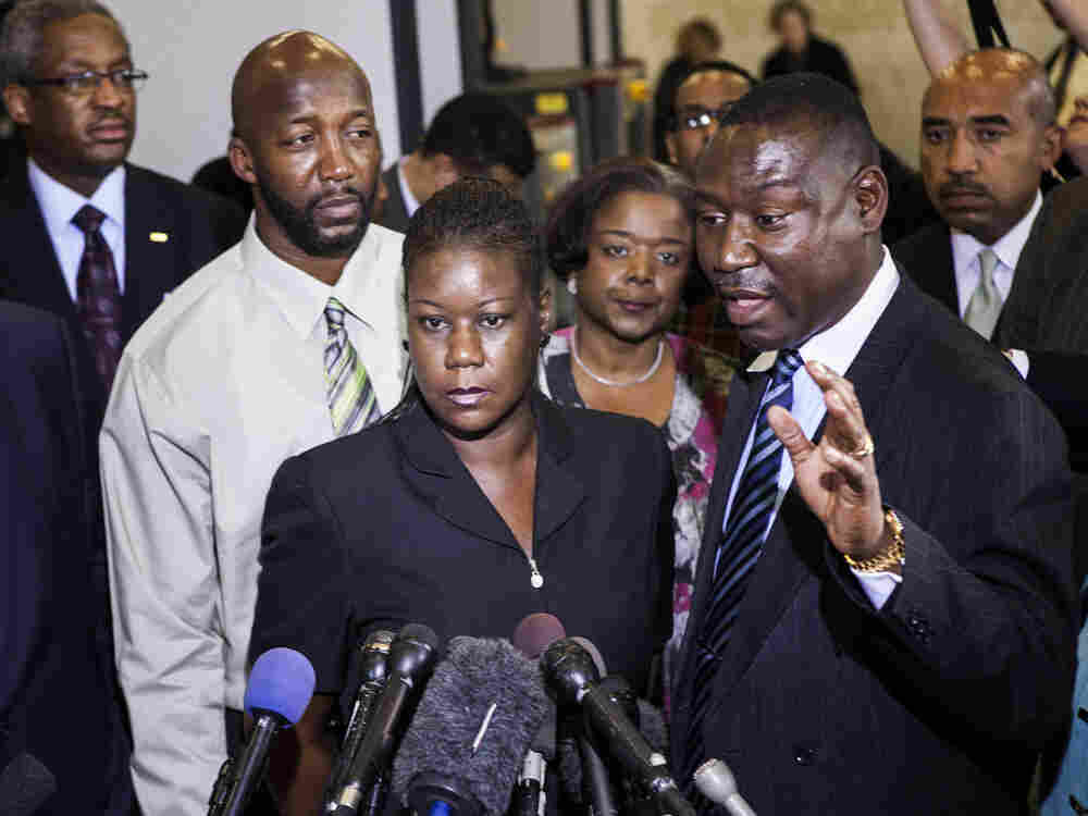 Sybrina Fulton (C) and Tracy Martin (L), parents of Trayvon Martin, listen while their friend and lawyer Benjamin Crump speaks to the press after a forum of Democratic members of the House Judiciary Committee on Capitol Hill March 27, 2012 in Washington, DC. In the second hour, we'll talk about how the news media is covering the Trayvon Martin case.