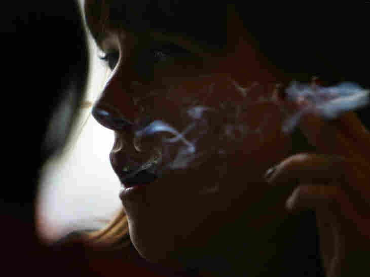 A woman smoking marijuana at an Amsterdam cafe in February 2007.