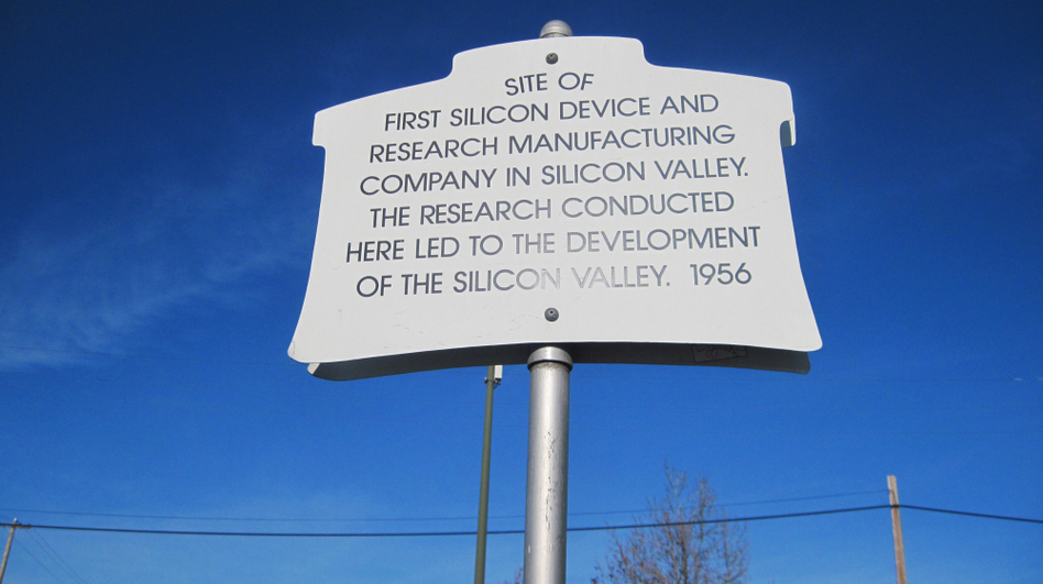 A plaque commemorating where Shockley set up in a lab in 1956. Shockley wanted to make better silicon-based transistors, but soon abandoned the pursuit. The building now houses an international produce market. (NPR)