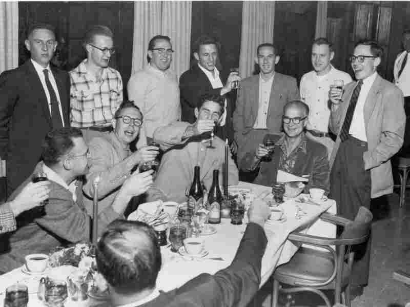 """William Shockley (at head of table) celebrates winning a share of the 1956 Nobel Prize. Gordon Moore (seated far left), Sheldon Roberts (next to Moore), Robert Noyce (middle standing), and Jay Last (far right) are half of the """"Traitorous Eight."""""""