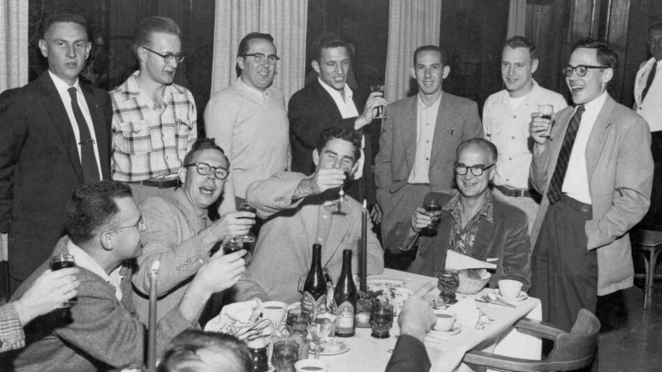 "William Shockley (at head of table) celebrates winning a share of the 1956 Nobel Prize. Gordon Moore (seated far left), Sheldon Roberts (next to Moore), Robert Noyce (middle standing), and Jay Last (far right) are half of the ""Traitorous Eight.""  (Courtesy of Intel)"