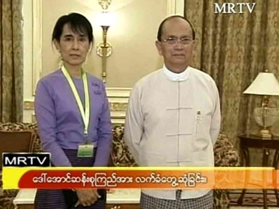 A screen grab from MRTV of Nobel Peace Prize winner Aung San Suu Kyi with Myanmar president Thein Sein dur