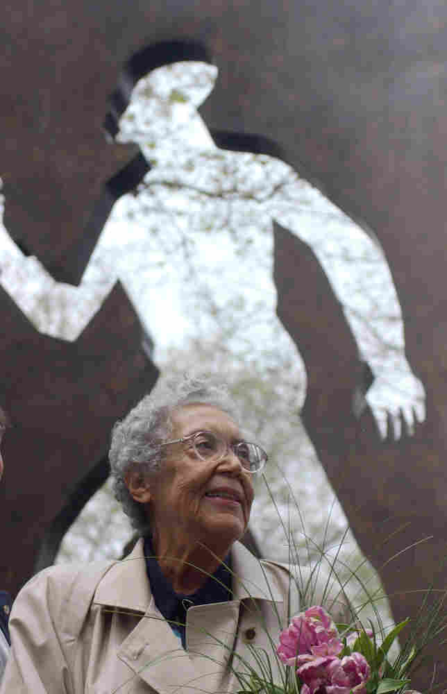 Sculptor Elizabeth Catlett shown in front of her Invisible Man sculpture in New York City in 2003.