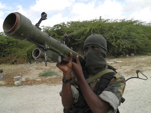 An al-Shabab fighter displays a weapon during military exercises in northern Mogadishu, Somalia, in 2010.