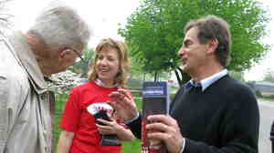 Republican Senate candidate Richard Mourdock (right) speaks with potential voters on March 31 in Evansville, Ind.